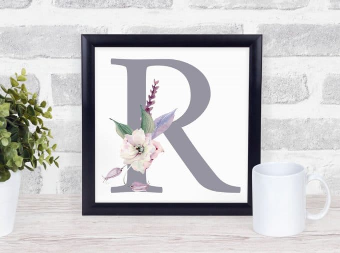 free mothers day monogram printable letter r with flowers in a frame on wood surface with coffee mug
