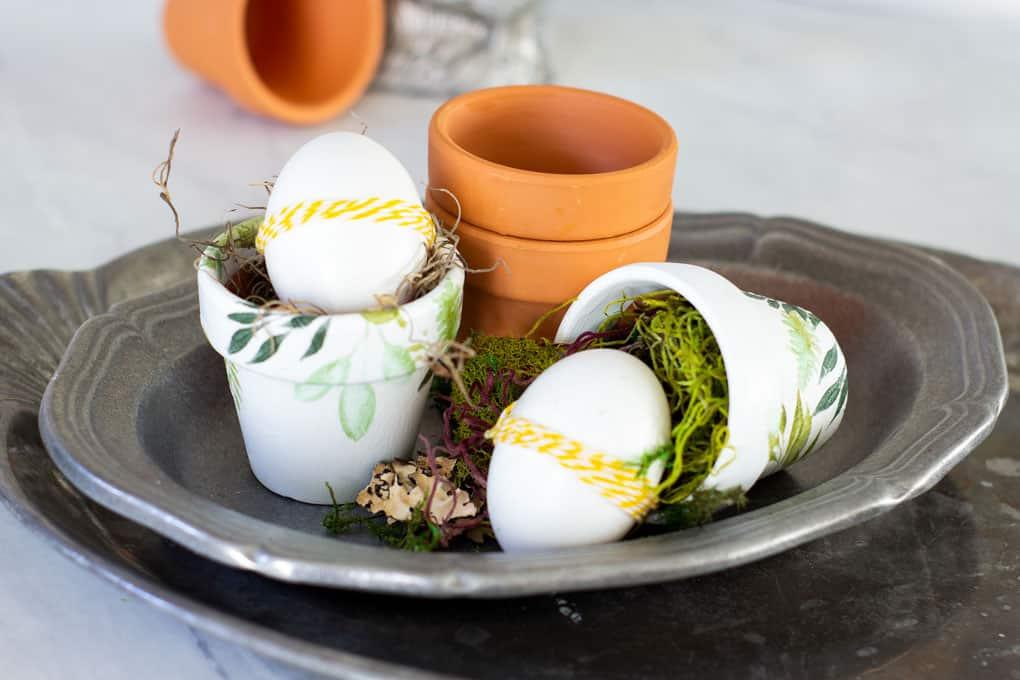 mod podge terra cotta pot with eggs on pewter platter