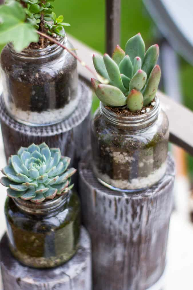 quick and easy summer apartment porch glass jars with succulents on pilings