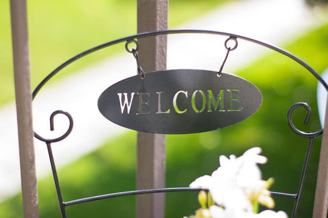 quick and easy summer apartment porch black welcome sign