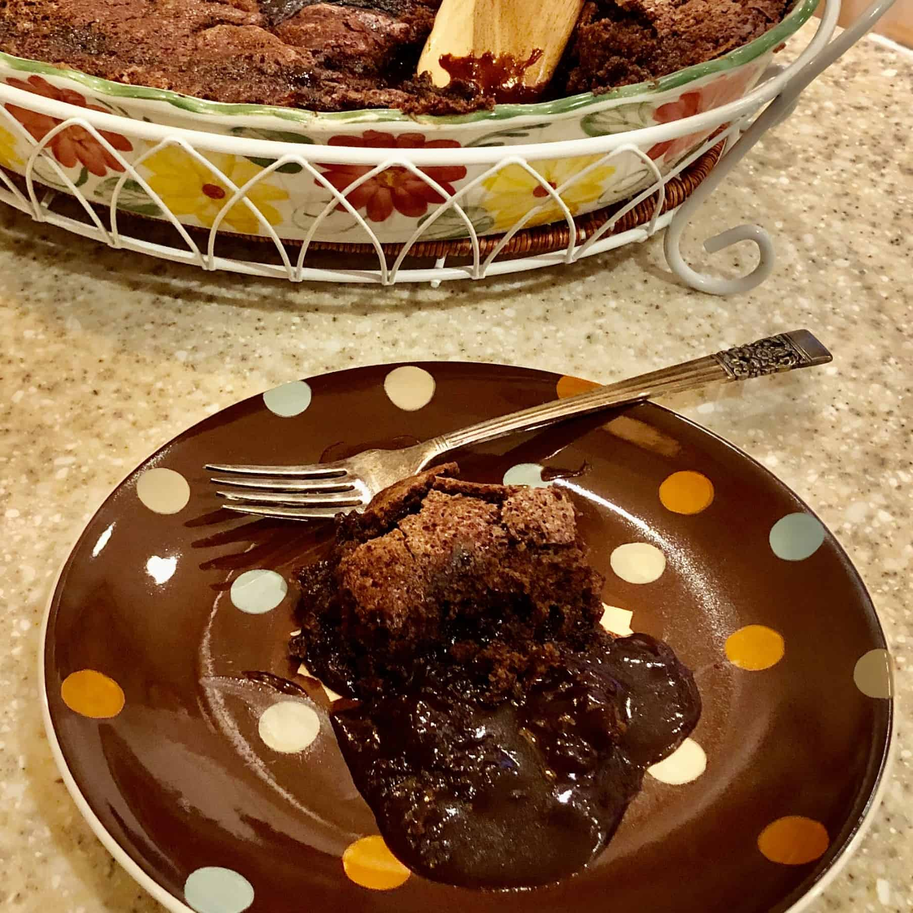 chocolate cobbler on polka dot plate with fork
