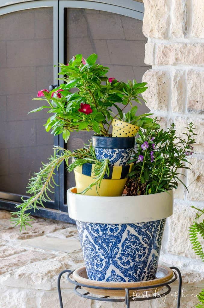 tuesday turn about blue white and yelow pots on a patio