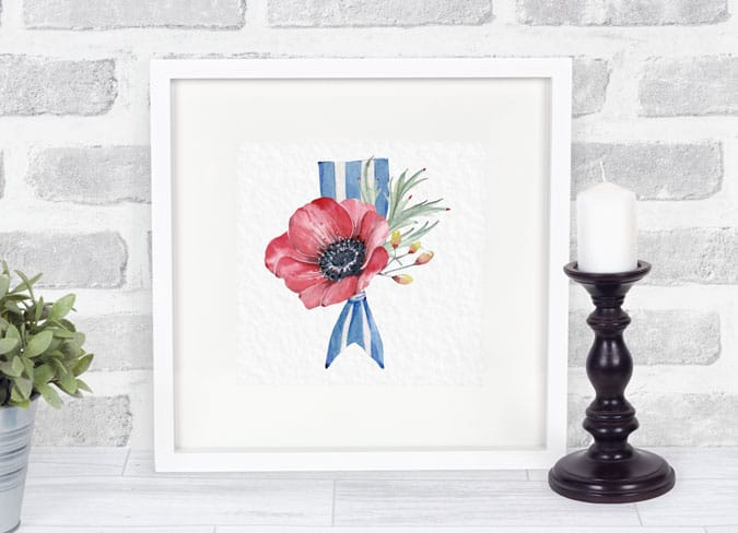 white frame with red white blue pennant and flowers