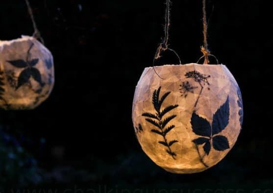 hanging lantern with pressed flower silhouettes