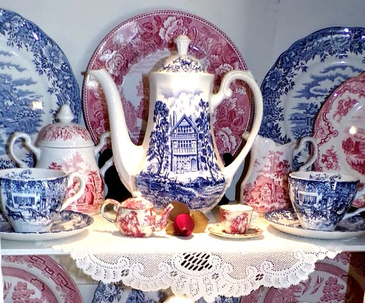 red white and blue transferware in cabinet