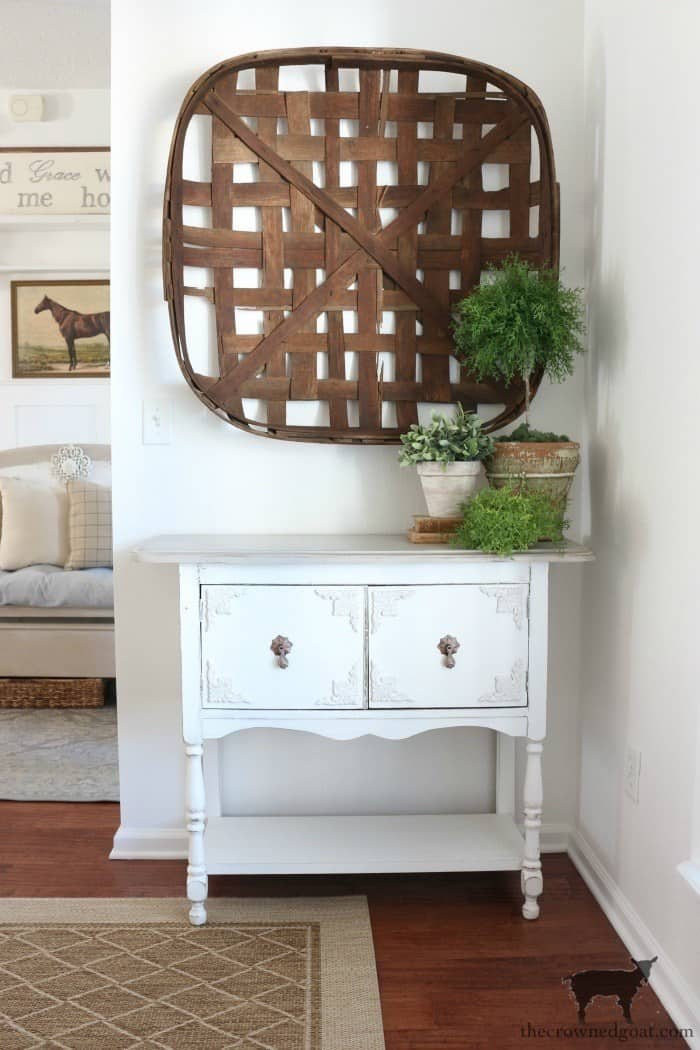 white buffet with farmhouse elements and tobacco basket