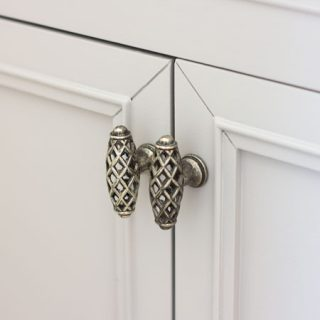 closeup of gray cabinet doors with hardware