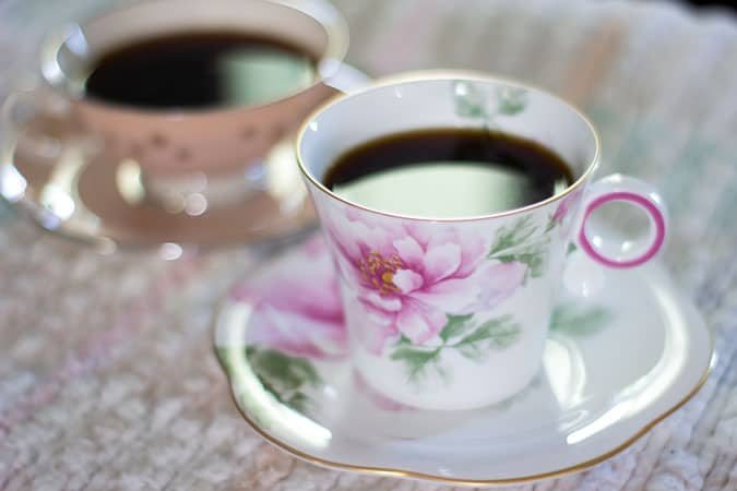 floral teacup and saucer with coffee inside