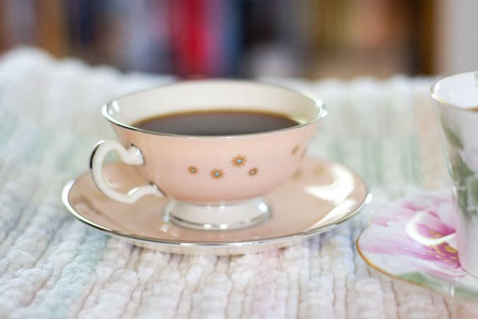 blush teacup with silver edging and turquoise dots
