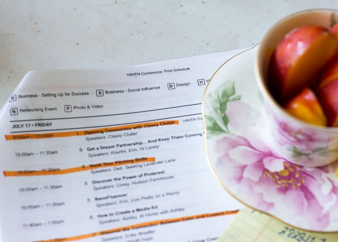 highlighted schedule on table with teacup on the side