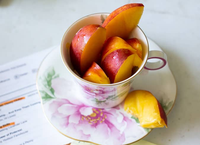 so cal traveling teacup with sliced nectarines inside