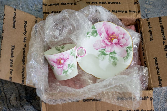 pink floral cup and saucer in packing and a box