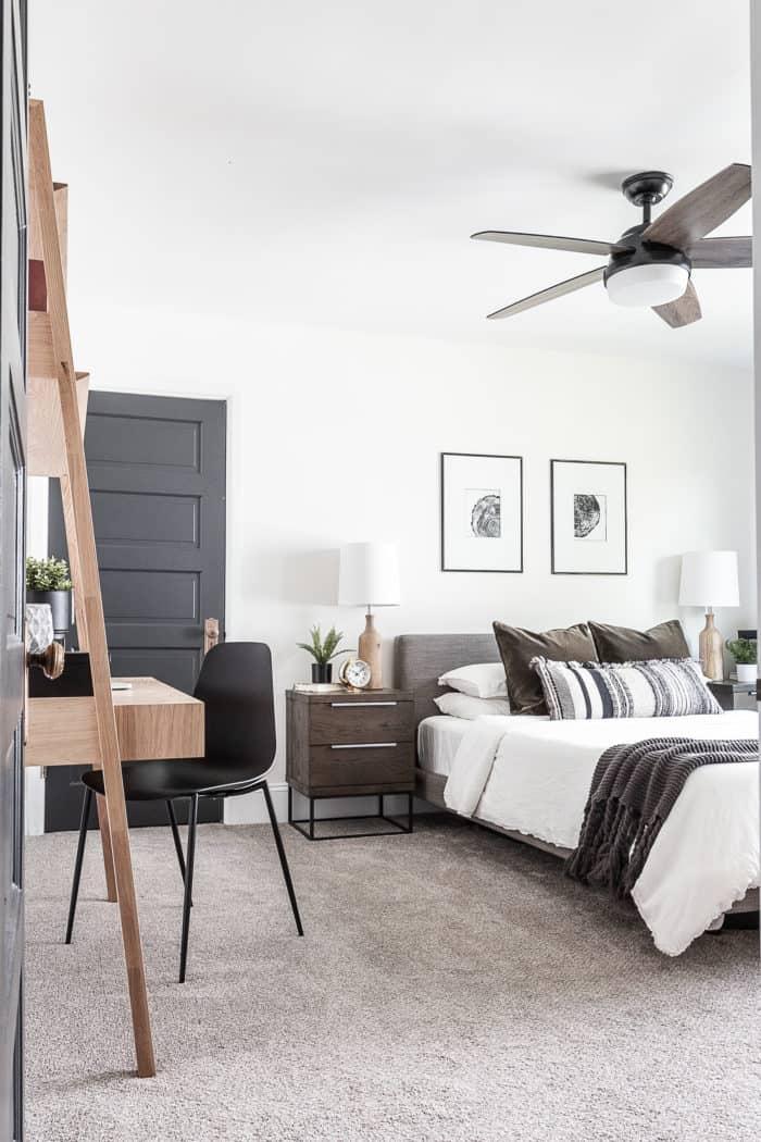 modern rustic bedroom in wood tones blacks whites and grays