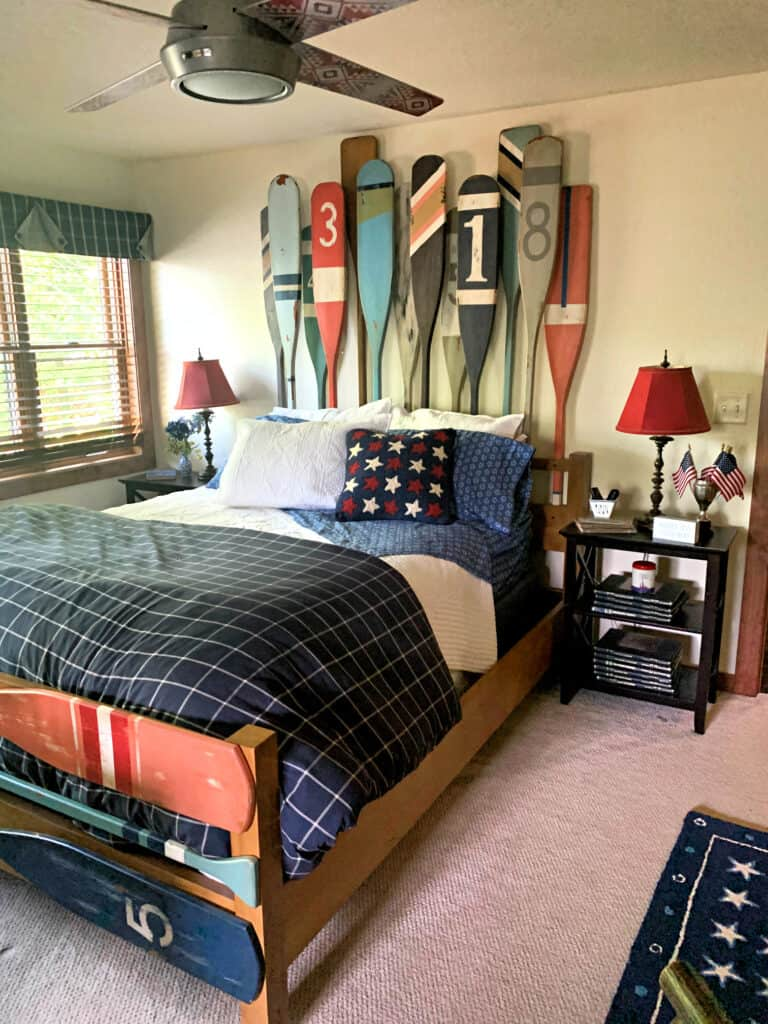 rustic bedroom with headboard made of oars and blue and red decor