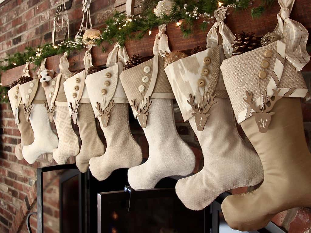 tuesday turn about 59 christmas in july stockings on mantel in neutral tones