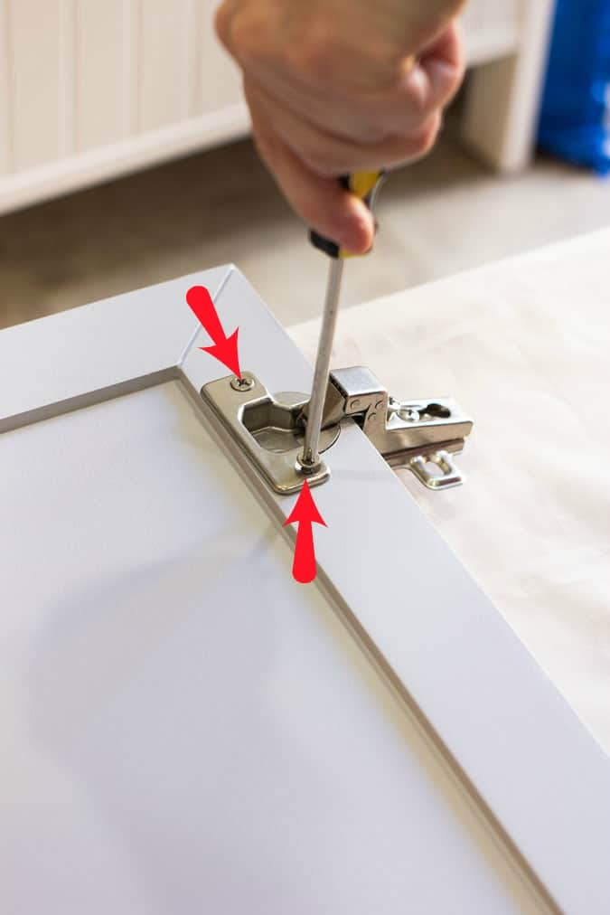 installing hinges on a cabinet door