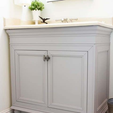 diy painted bathroom cabinets in gray with cream countertop