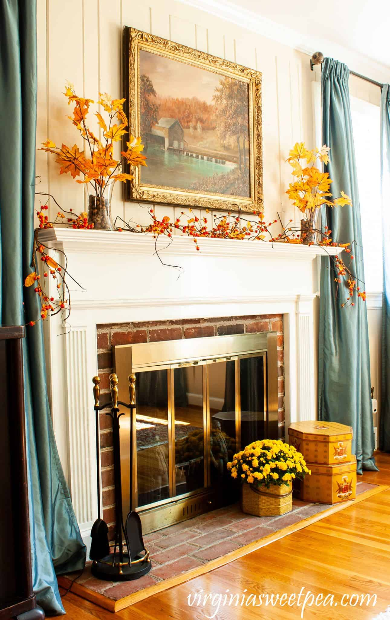 fall decorating ideas traditional mantel with bittersweet and fall decor