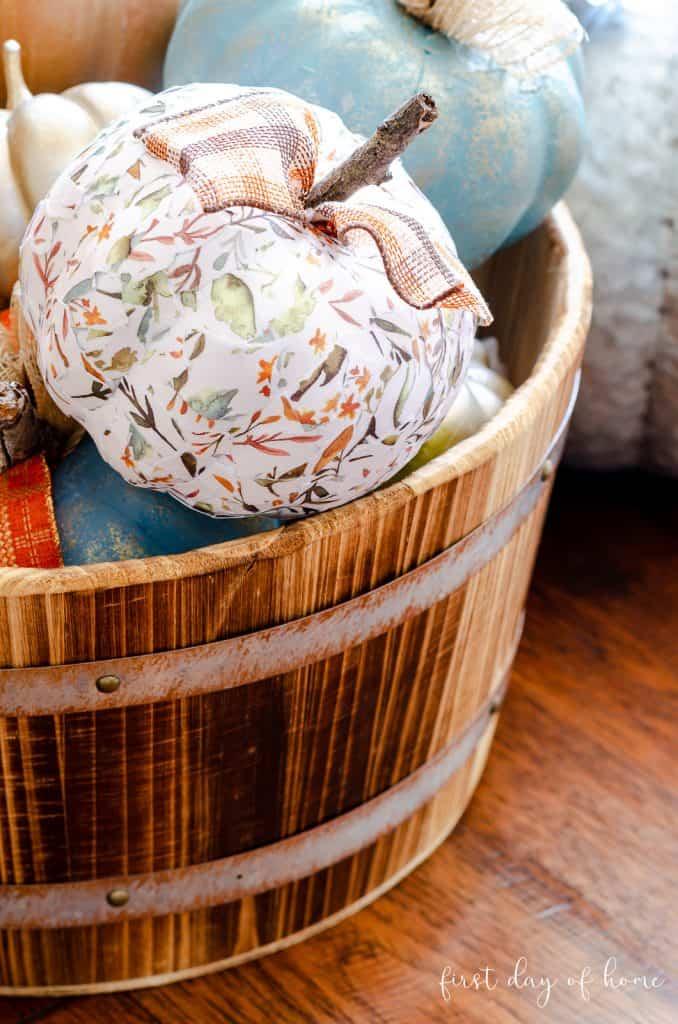 decoupage pumpkin in wooden bucket