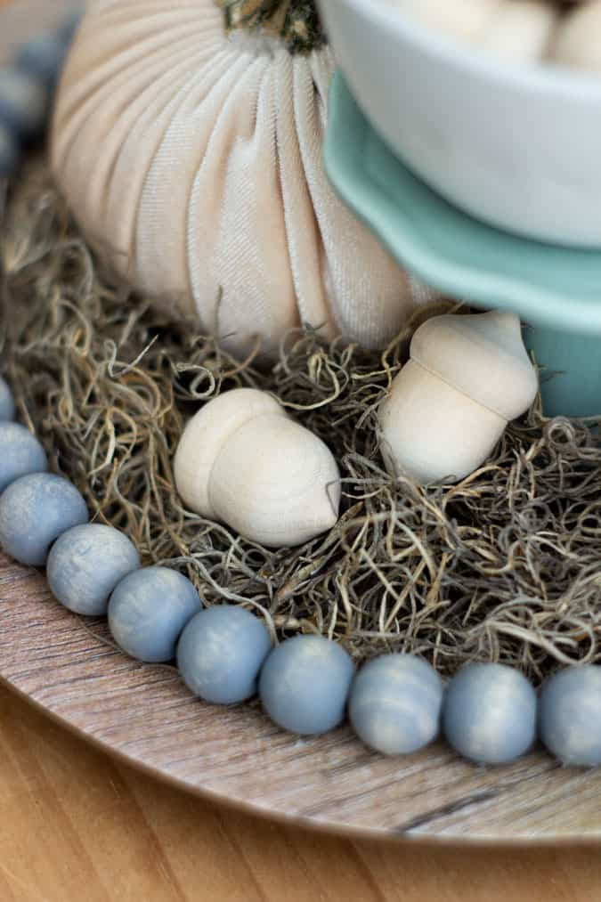 neutral fall cloche acorns on moss with wooden beads