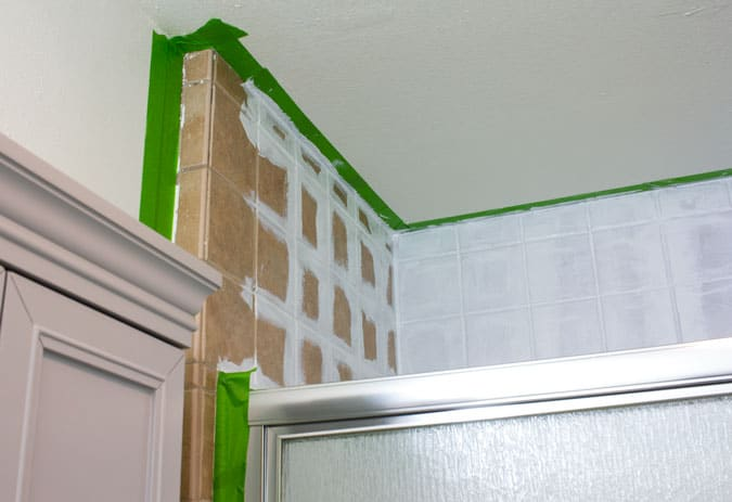 brown shower tile with white paint