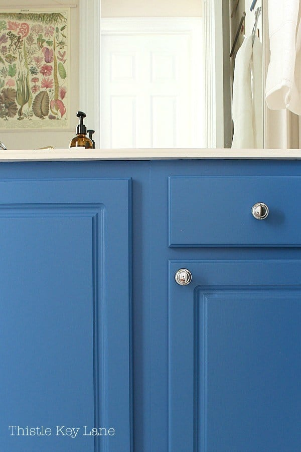 blue vanity cupboards with silver hardware