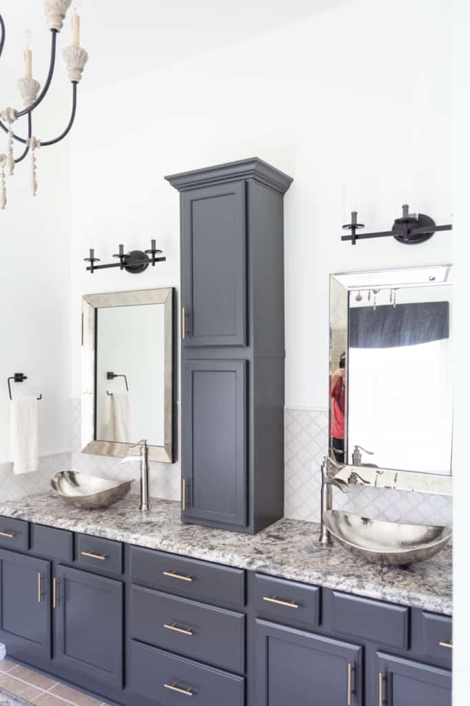 bathroom with gray cabinets and granite counters