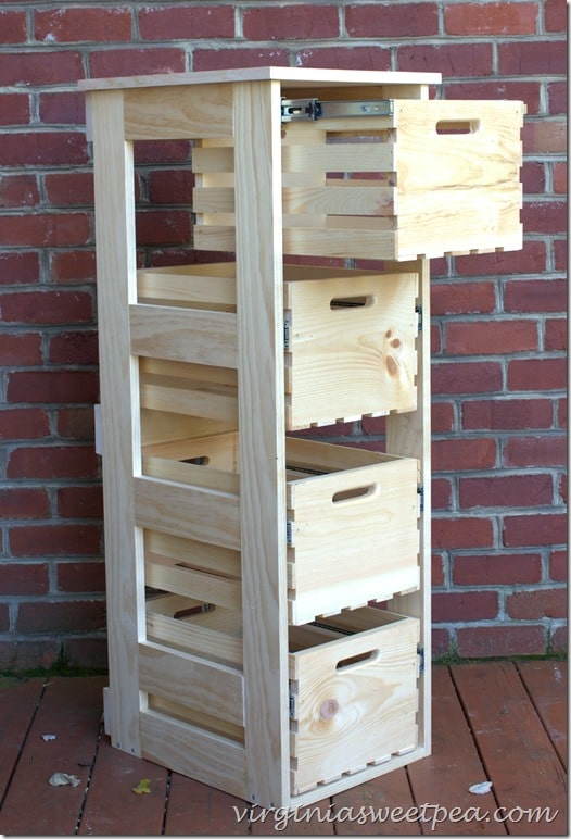 crate filing cabinet with brick wall in background