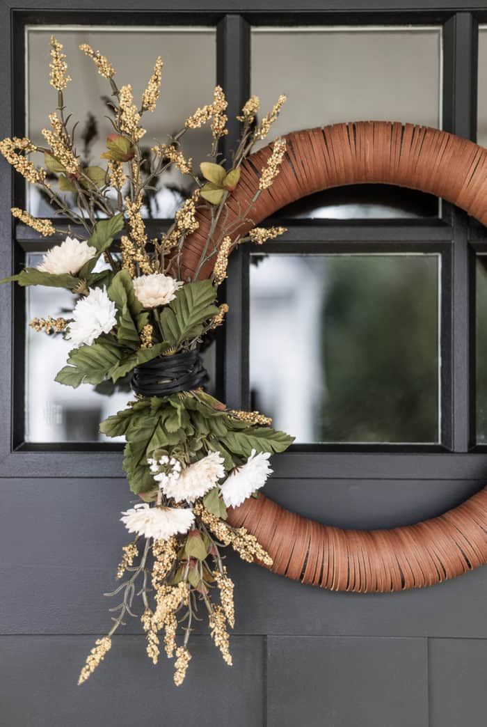 wreath with leather accent and florals