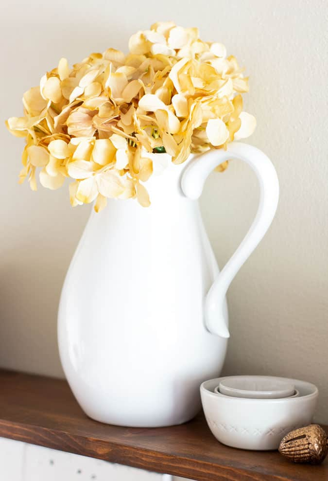 apartment fall decor with white pitcher and hydrangeas