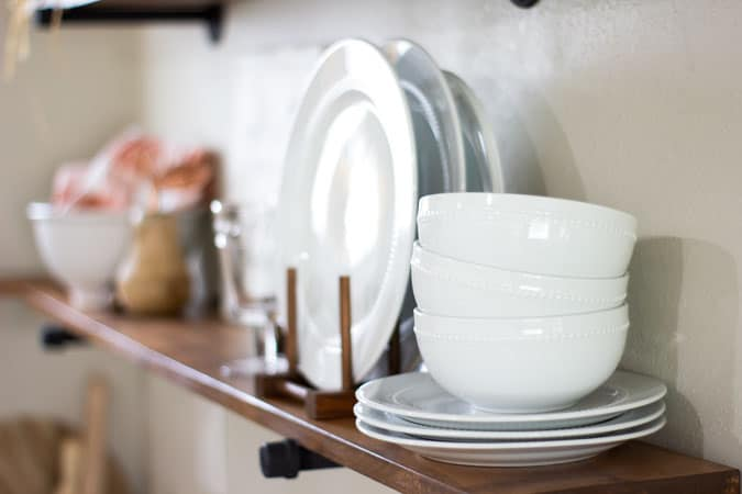 white dishes on open shelf