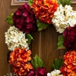 You can make this gorgeous DIY hydrangea wreath for WAY less than offered on Etsy! And it only takes fifteen minutes to create this autumn wreath. Use any color of hydrangea you want to create it for summer, spring, winter, and autumn!