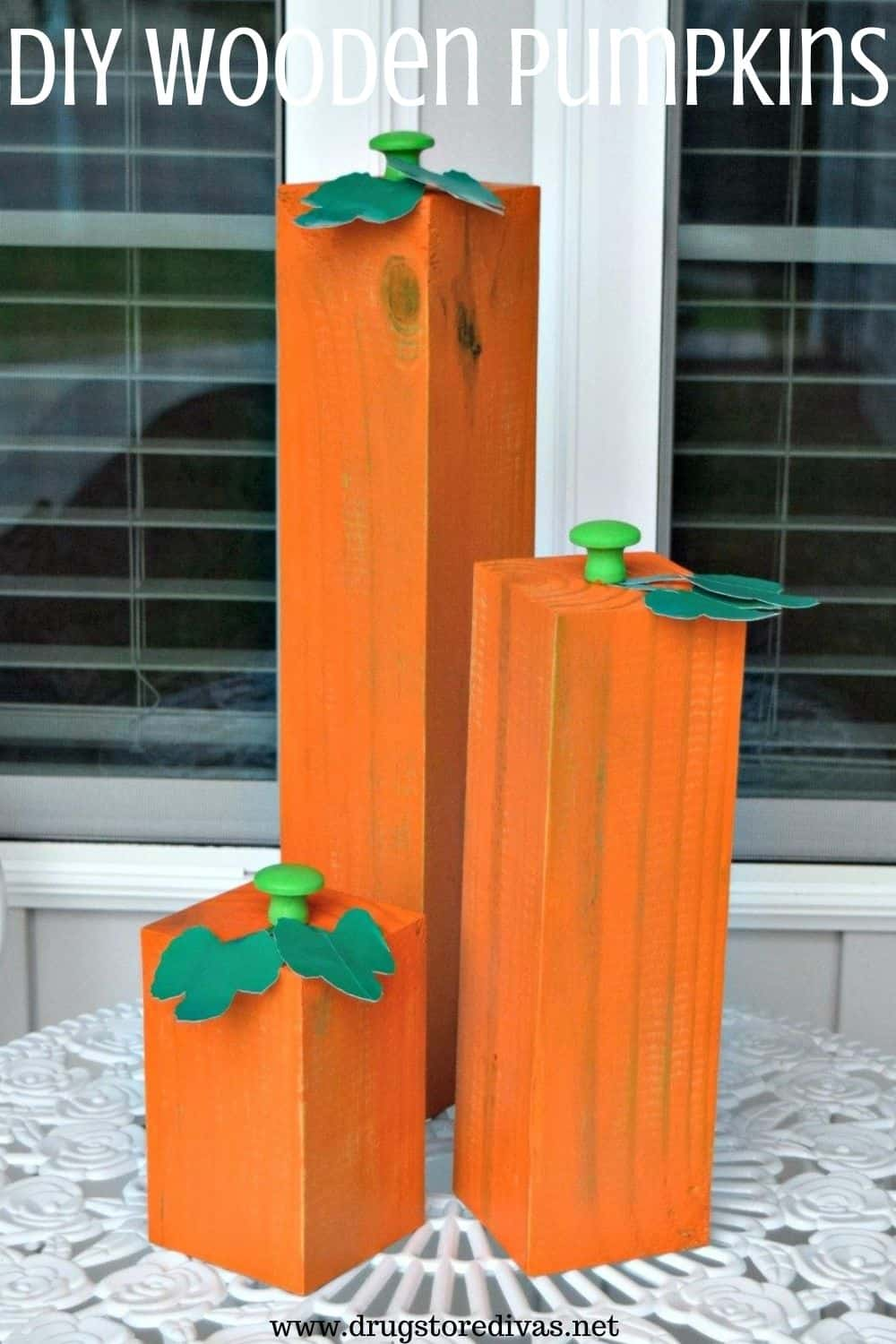 wooden pumpkin decor made from 4 by 4 wood
