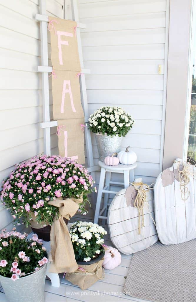 tuesday turn about 68 fall porch with mums and wood pumpkins and fall sign
