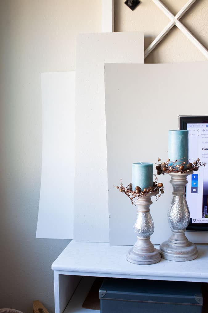 9 tips for choosing the perfect wall paint color candlesticks on table with painted boards