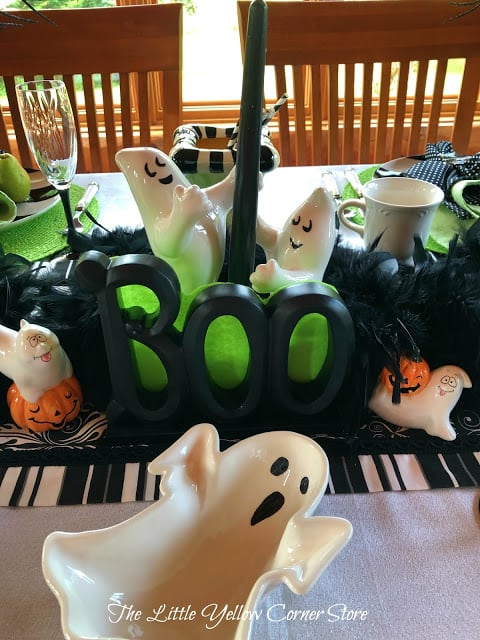 halloween tablescape in black green and white ghosts
