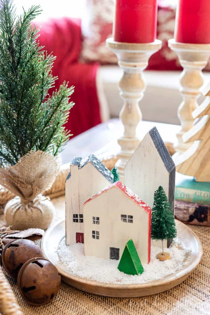 christmas decor and diy ideas wooden houses on round tray with snow and trees with other decor