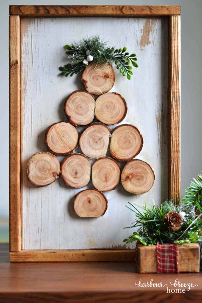 wood slice christmas tree art with sprig of greenery