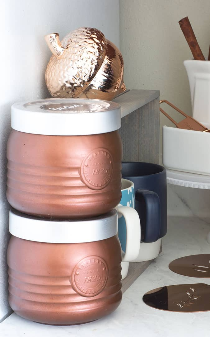 fall coffee cubby with coffee containers in copper