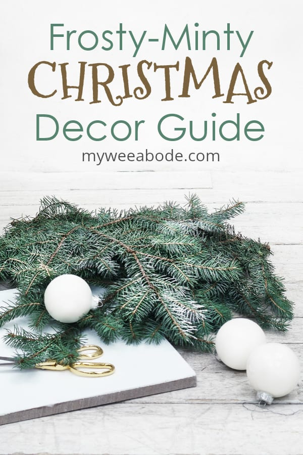 frosty mint christmas decor guide pine branches with christmas ornaments and gold scissors