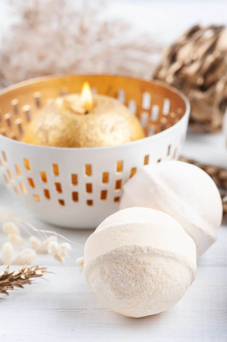 tuesday turn about sensitive skin bath bombs with gold candle on white surface