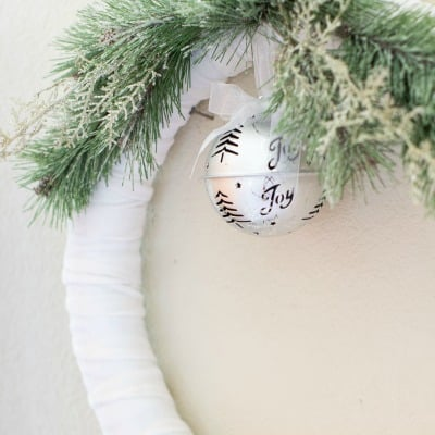 frosty velvet christmas wreath with a jingle bell