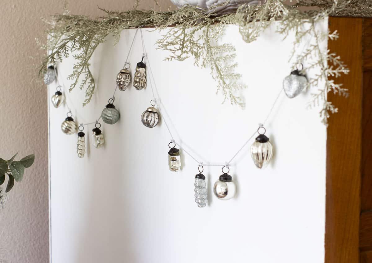 mercury ornament garland on back of hutch