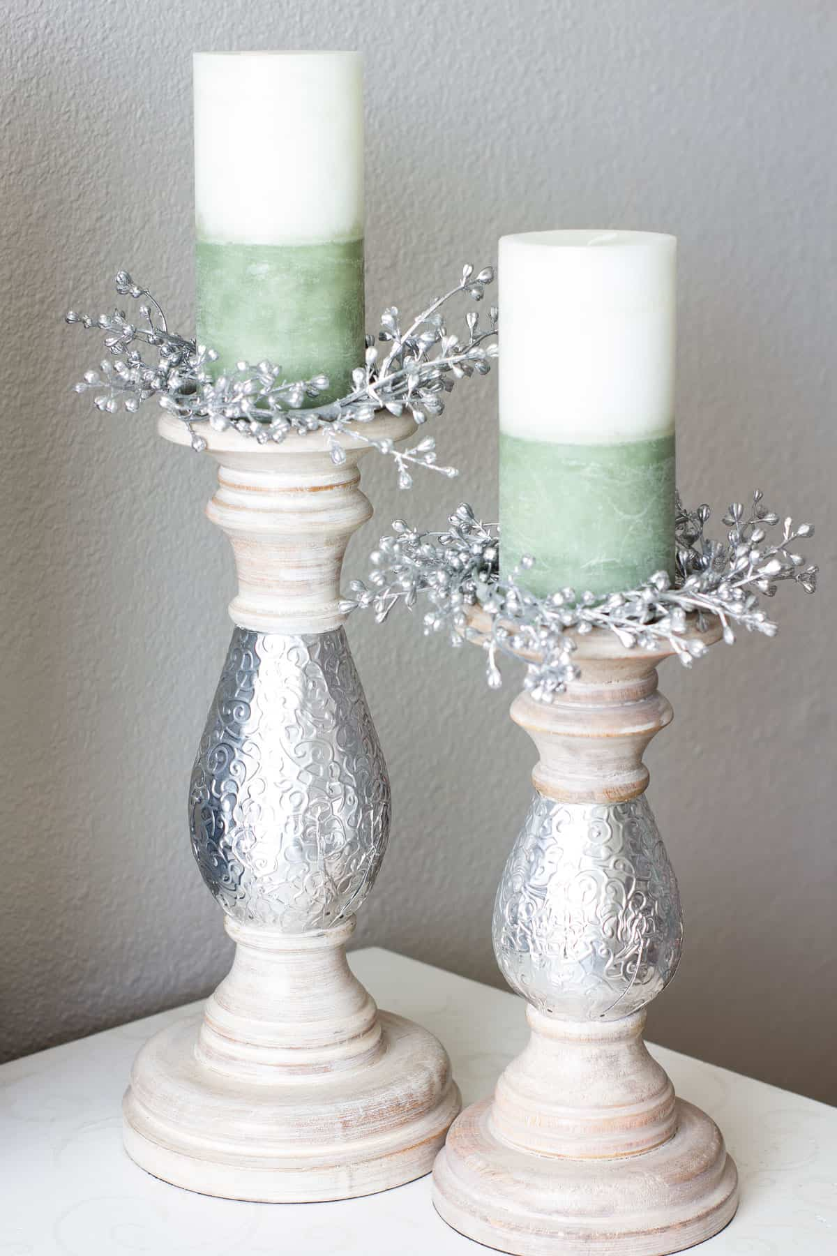 candle holders with green and white candle and sparkly candle rings
