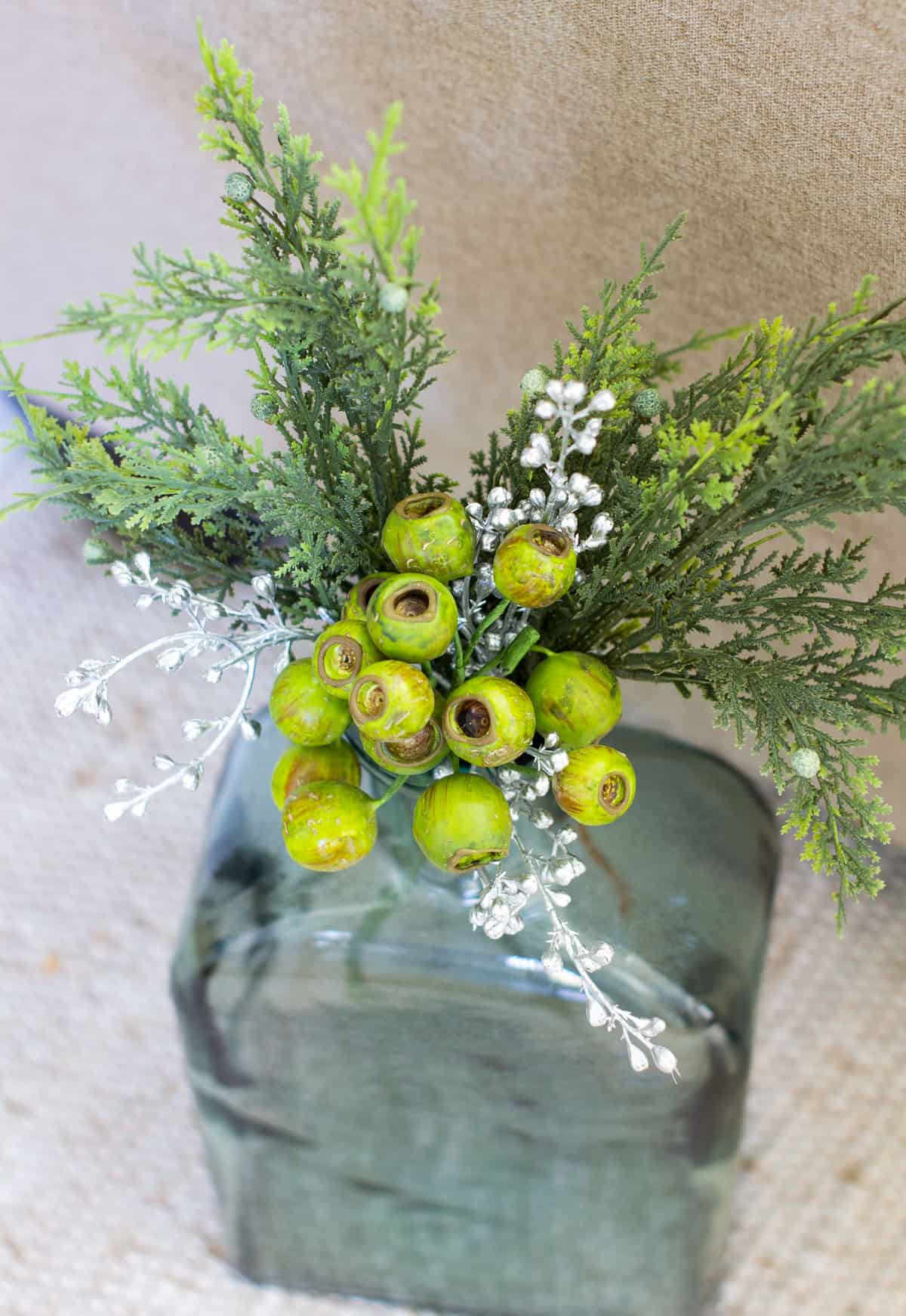 vase with christmas foliage