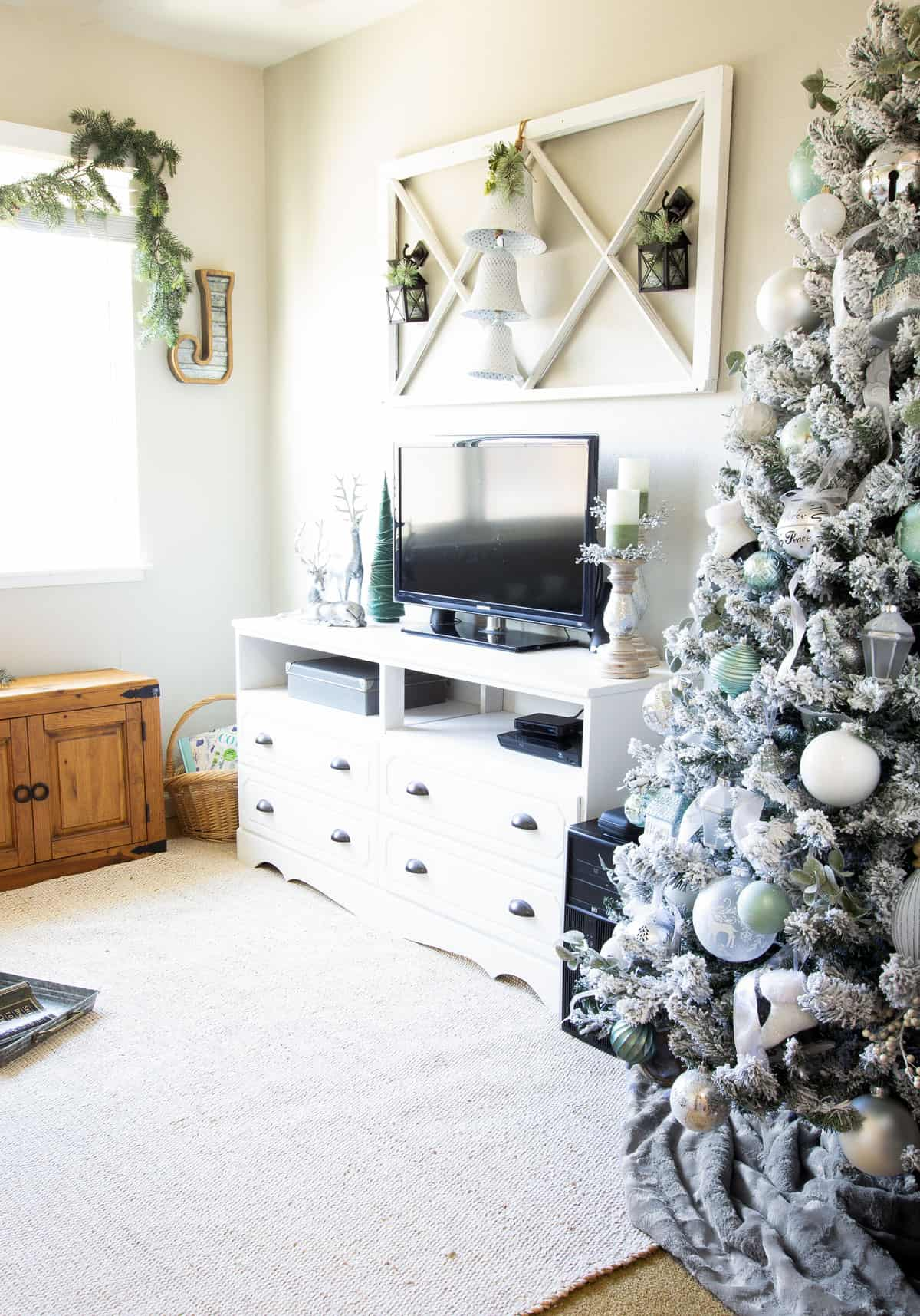 frosty christmas tiny home tour living area with christmas tree in mint and white and minty decor