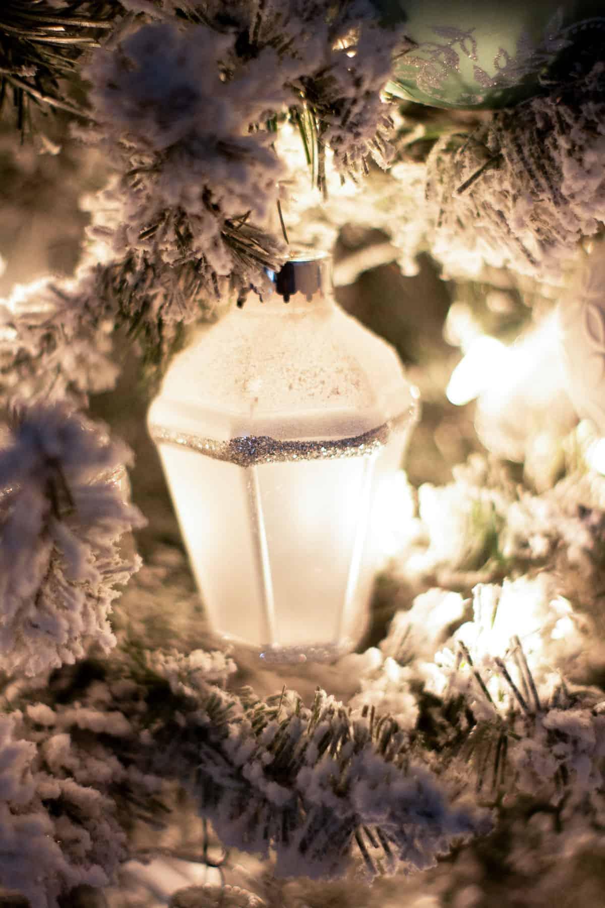 lantern ornament on flocked tree