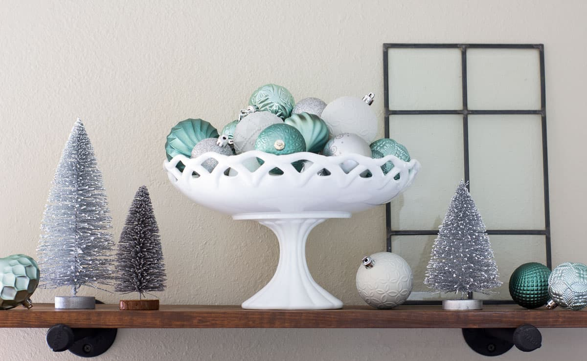 open shelves with mint and silver christmas decor