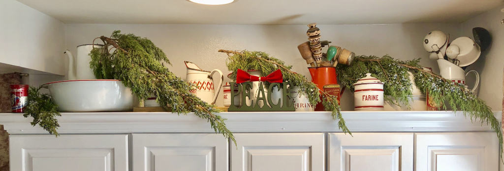 christmas kitchen cabinet decor with greenery