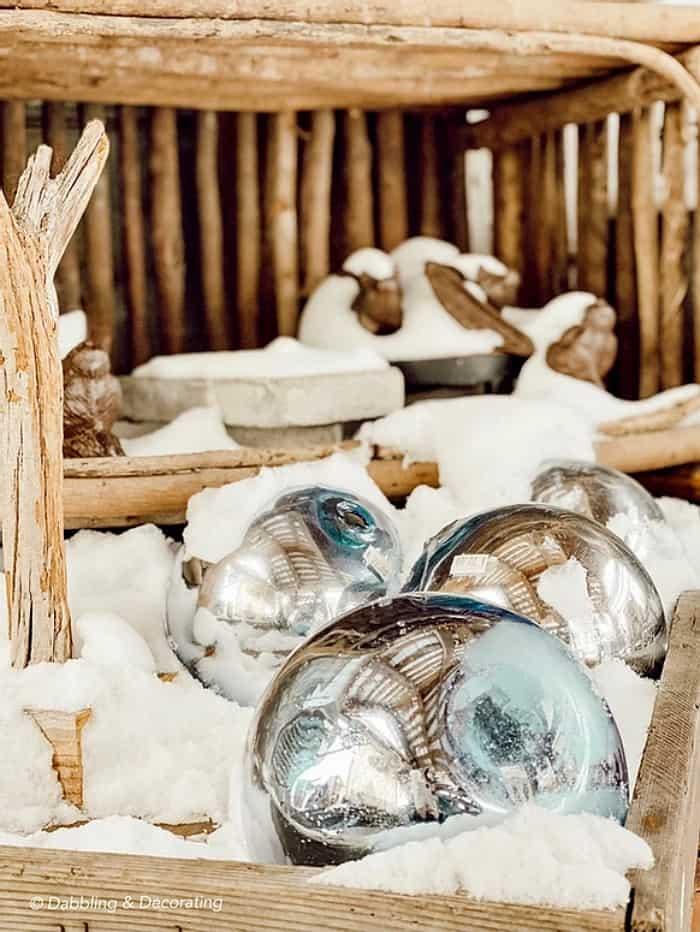 vintage ornaments in snow